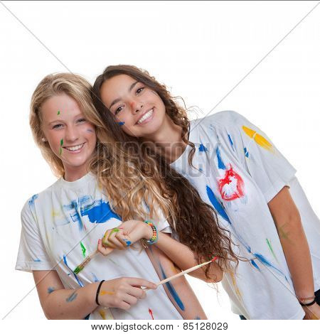 happy smiling studetns at art class with paint and brushes