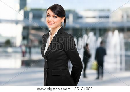 Smiling female manager in an urban setting