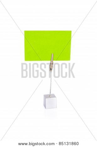 Blank business card in holder on white