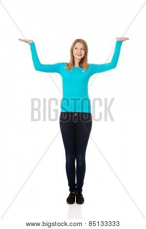 Teenage woman presenting something on both palms