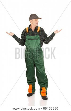Experienced gardener in uniform showing space in both hands