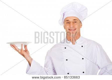 Restaurant chef holding white porcelain plate