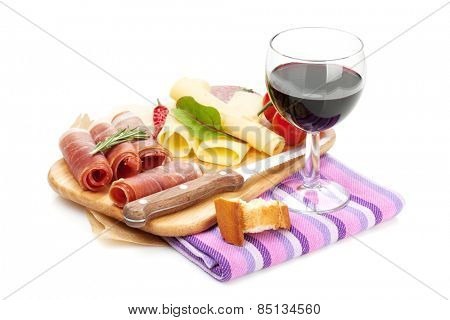 Red wine with cheese, prosciutto, bread, vegetables and spices. Isolated on white background