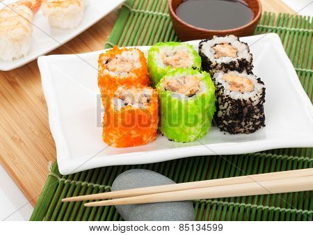 Sushi maki and shrimp sushi on bamboo mat