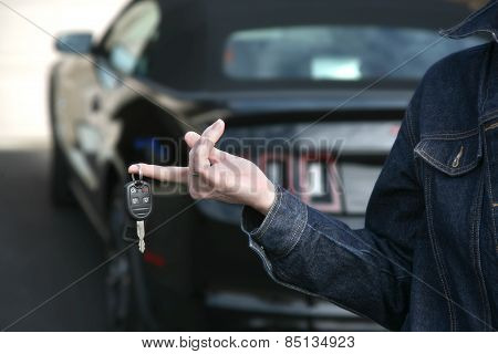 Woman holding keys new car