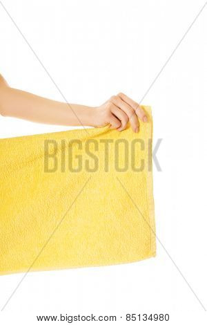 Female hand holding yellow towel.