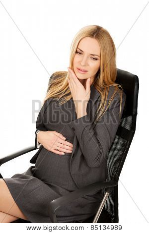 Pregnant woman in the office suffering from tooth pain