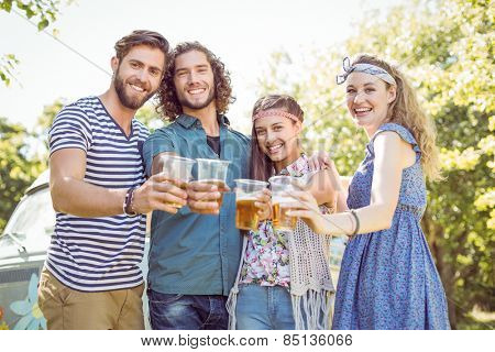 Hipster friends having a beer together on a summers day