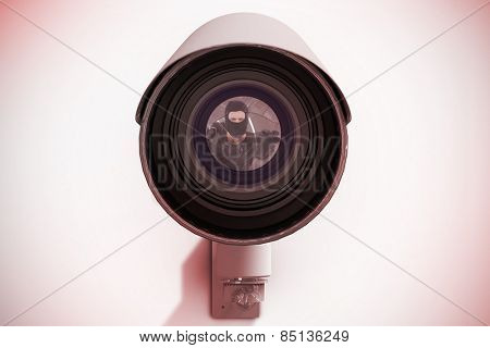 Hacker reaching out to camera against cctv camera