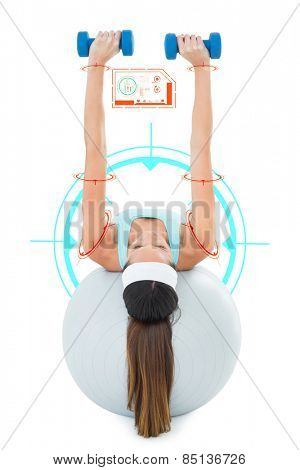 Woman exercising with dumbbells on fitness ball against fitness interface