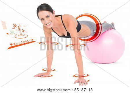 Fit woman doing push ups on fitness ball against fitness interface
