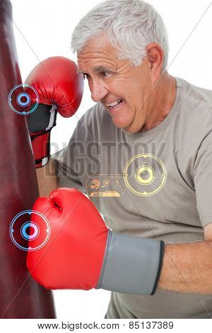 Portrait of a determined senior boxer against fitness interface