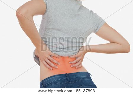 Rear view of woman with backache over white background