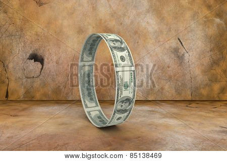 Wheel of dollars against brown background