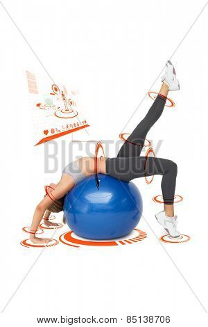 Fit young woman stretching on fitness ball against fitness interface