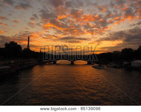 The Seine and Eiffel Tower Against a Colorful Sunset