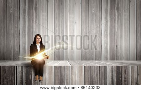 Young smiling businesswoman with book in hands