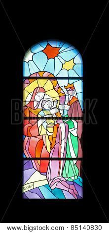 MEDUGORJE, BOSNIA AND HERZEGOVINA - FEBRUARY 19: Nativity Scene, Adoration of the Magi, stained glass church window in the parish church of St. James in Medugorje on February 19, 2011.