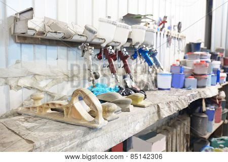 Workplace of car painter. Old spray guns.