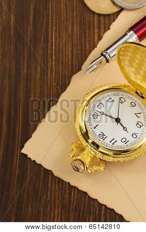 old pocket watch on wooden background