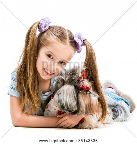 Happy smiling little girl with her dog Yorkshire Terrier isolated on white background