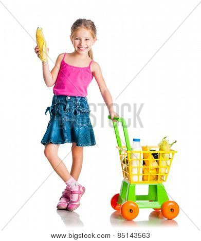 beautiful little girl with a basket from the supermarket holding corn