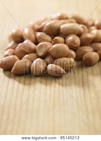 ground nuts on the wooden table