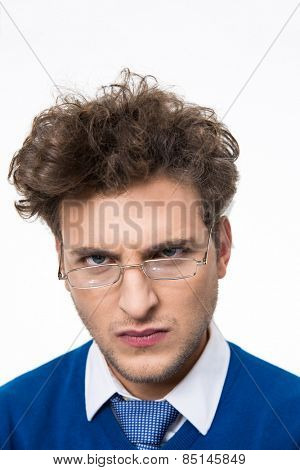Angry man in glasses looking at camera