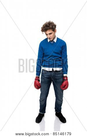 Full length portrait of a defeated young business man over white background