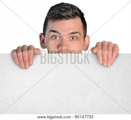 Isolated business man behind empty board