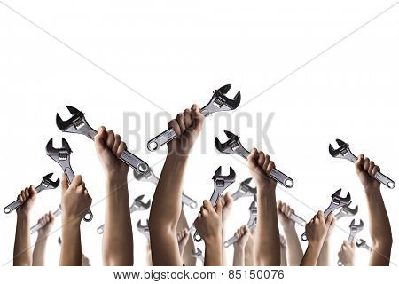 Large group of human hands with steel wrench
