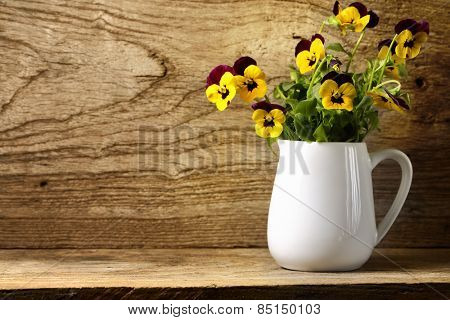 Pansy flower on wooden background