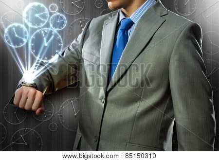 Close up of businessman looking at watch at his wrist