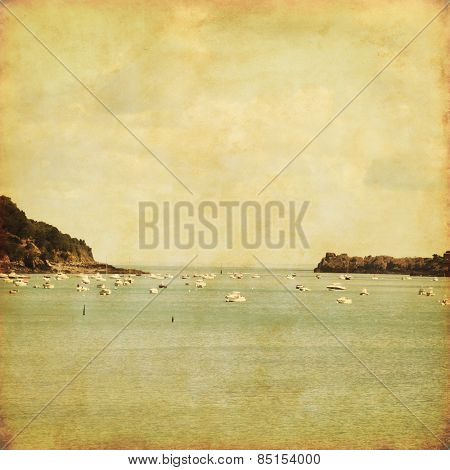 Seascape with fishing boats in grunge and retro style.