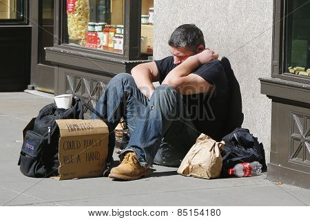 Homeless man at Madison Square in Midtown Manhattan