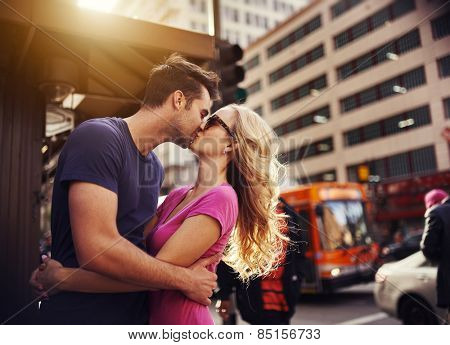 romantic couple kissing in down town los angeles