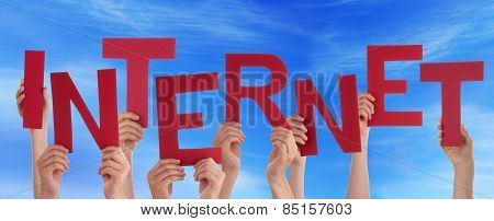 Many People Hands Holding Red Word Internet Blue Sky