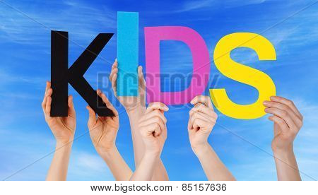 Many People Hands Holding Colorful Word Kids Blue Sky