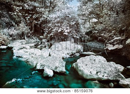 Mountain river with stones infrared (IR) landscape
