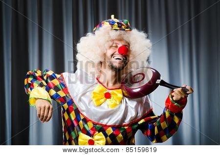 Angry clown with frying pan