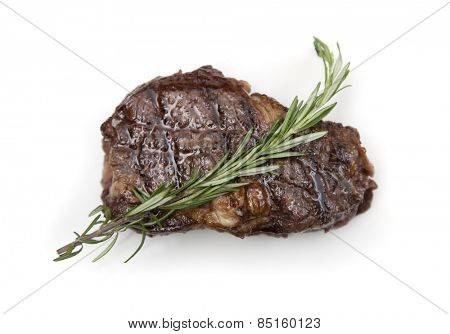 Juicy ribeye steak on white background