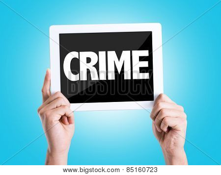 Tablet pc with text Crime with blue background