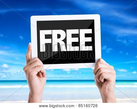 Tablet pc with text Free with beach background