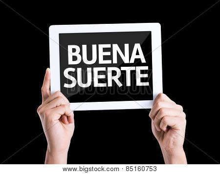 Tablet pc with text Good Luck (in Spanish) isolated on black background