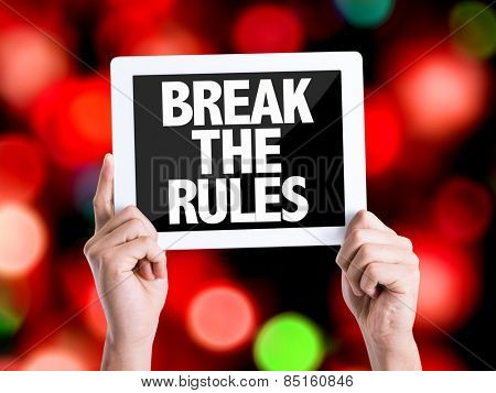 Tablet pc with text Break the Rules with bokeh background