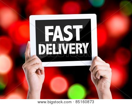 Tablet pc with text Fast Delivery with bokeh background