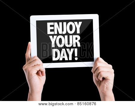 Tablet pc with text Enjoy Your Day isolated on black background