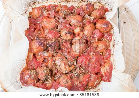 Oven Baked Chopped Sausages With Tomatoes And Garlic
