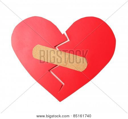 Broken heart with plaster isolated on white