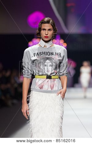 ZAGREB, CROATIA - OCTOBER 18, 2014: Fashion model wears clothes designed by Envy Room on the 'Fashion.hr' fashion show